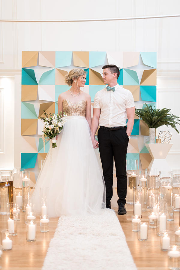 geometric paper wedding ceremony backdrop