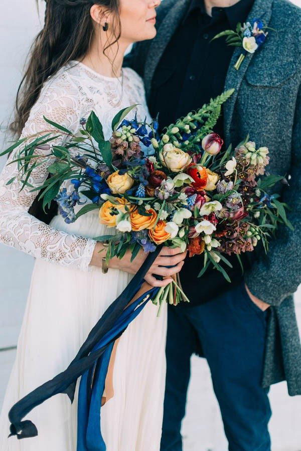 Rustic wedding bouquet with blue accents