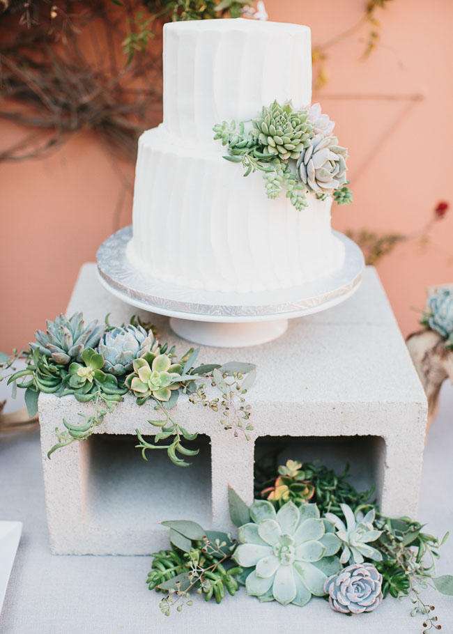 industrial wedding cake concrete display idea with cacti