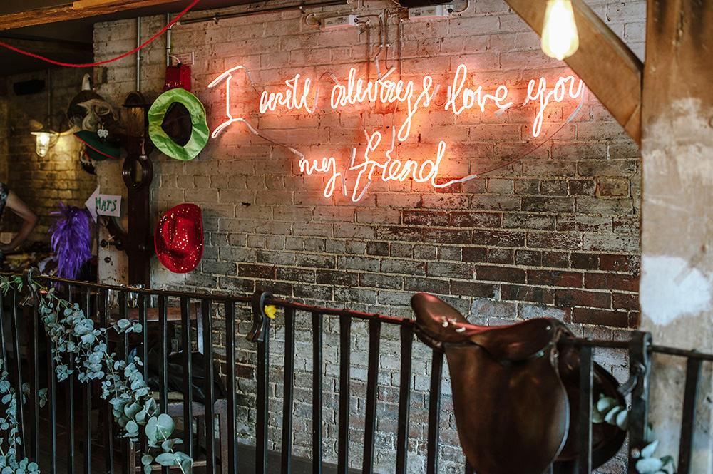 Warehouse wedding neon lighting