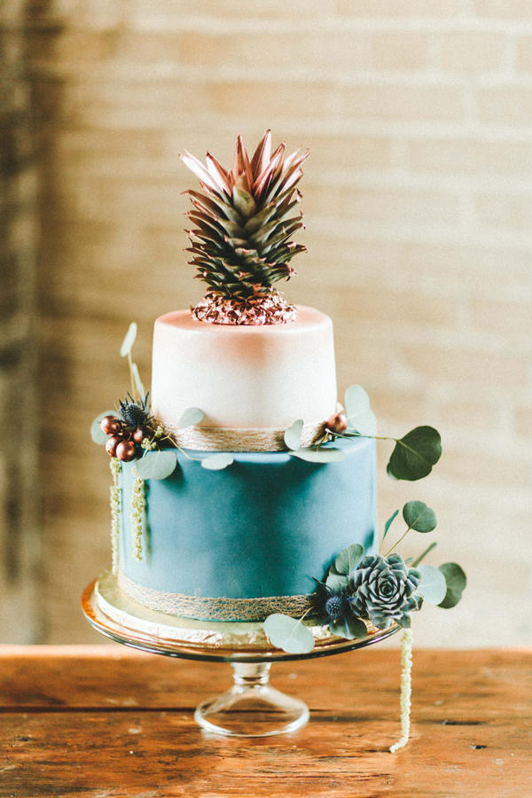 teal and copper wedding cake with pineapple topper
