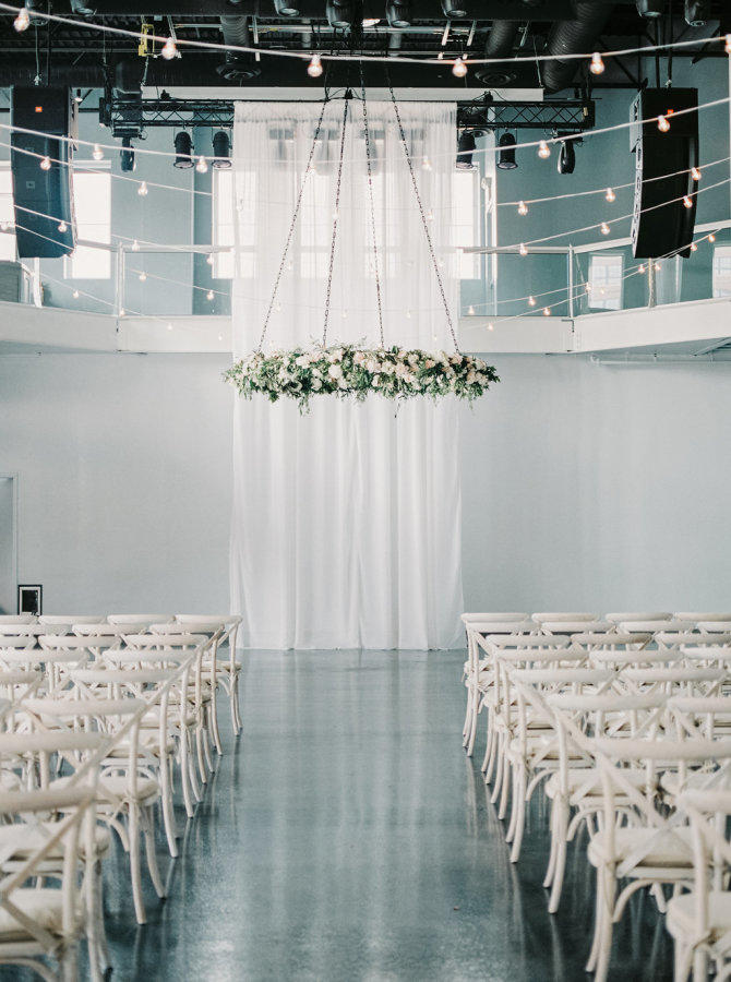 floral chandelier wedding ceremony backdrop