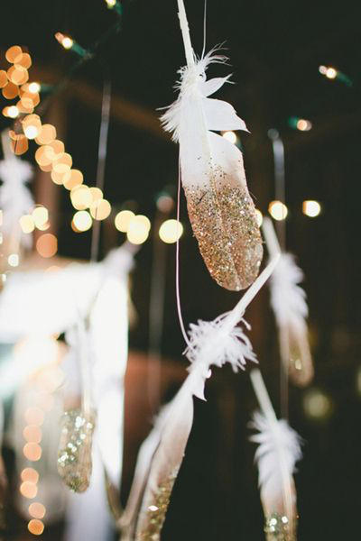 gold dipped feathers for warehouse wedding