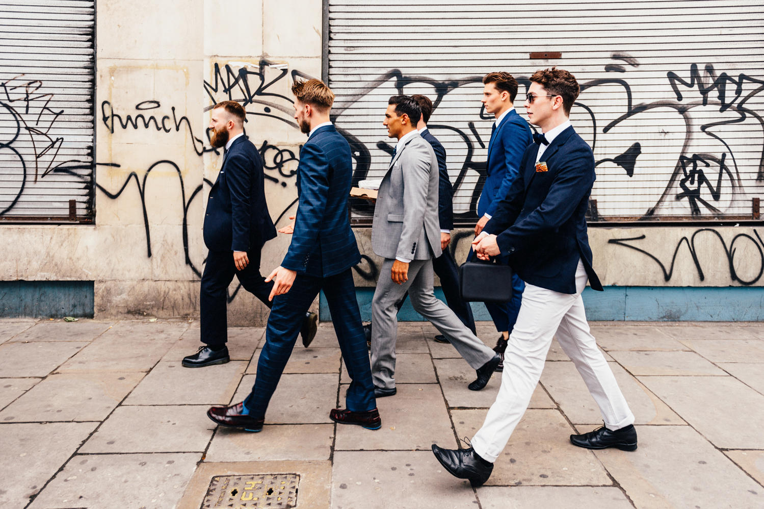 grooms men co-ordinated in blue