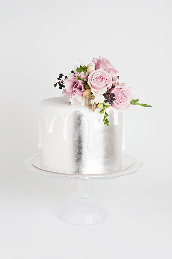 silver wedding cake with flowers