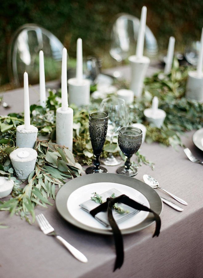 monochrome wedding table styling with greenery