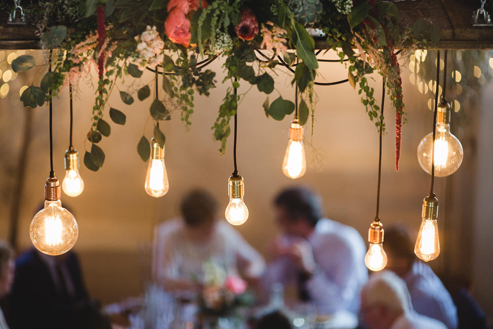 Autumn wedding Edison light bulb installation