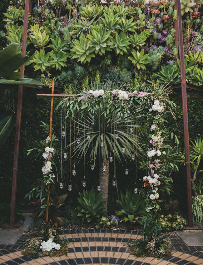 industrial wedding with greenery installation idea