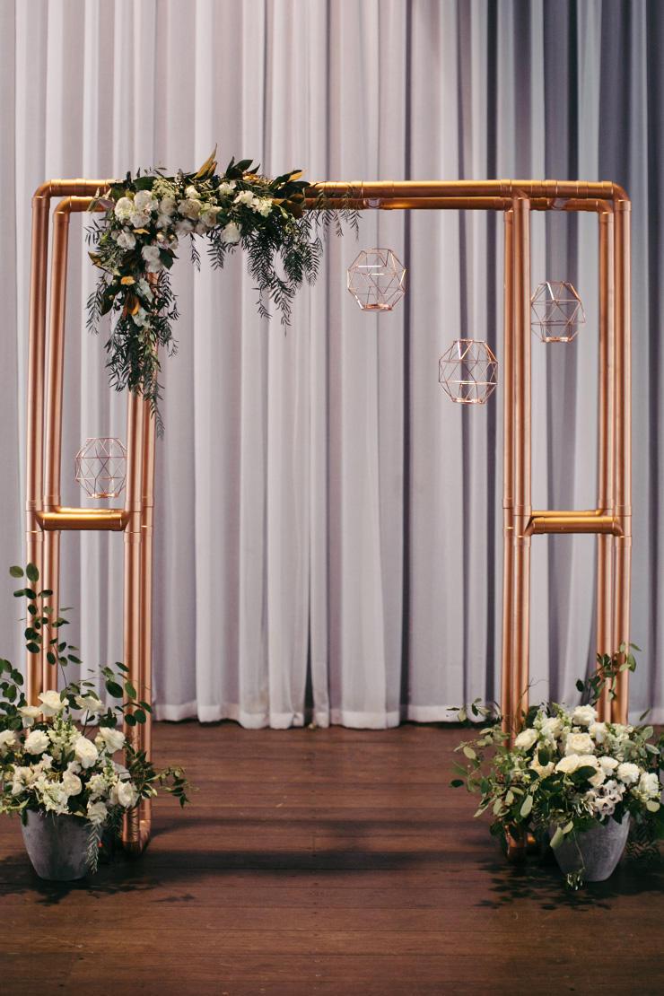 winter wedding industrial copper arch