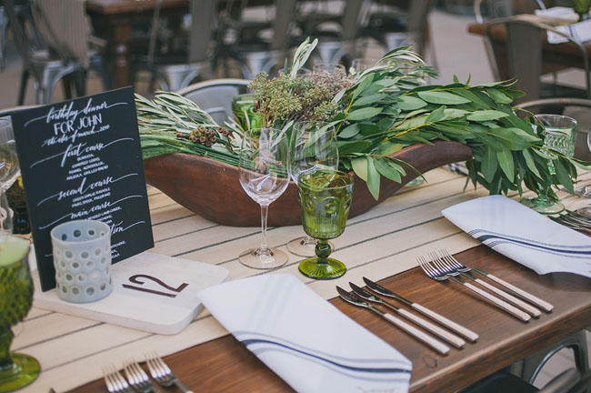 industrial wedding with greenery table styling