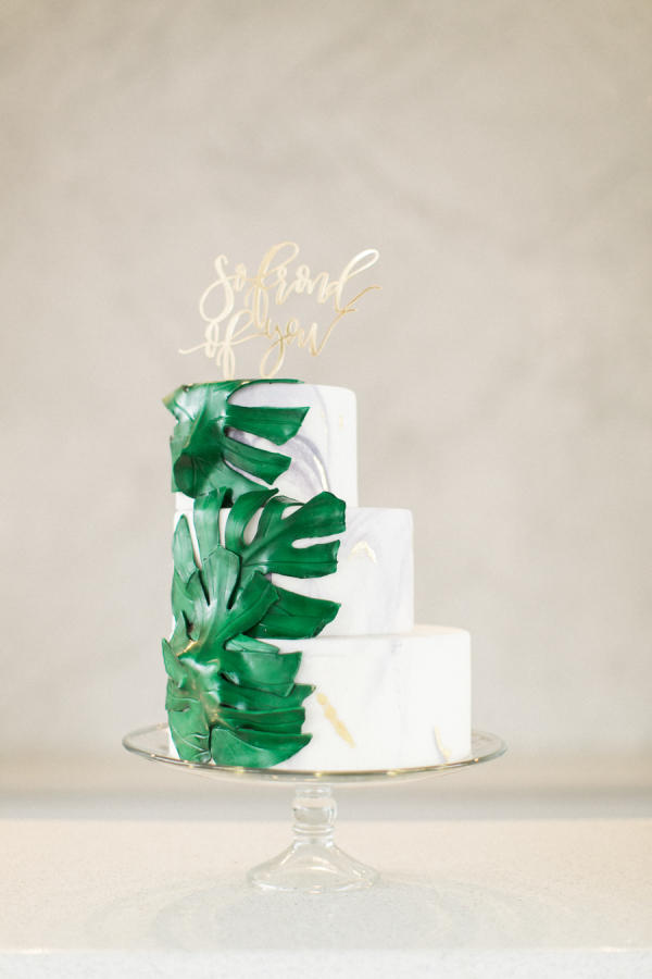 tropical wedding leaves cake styling
