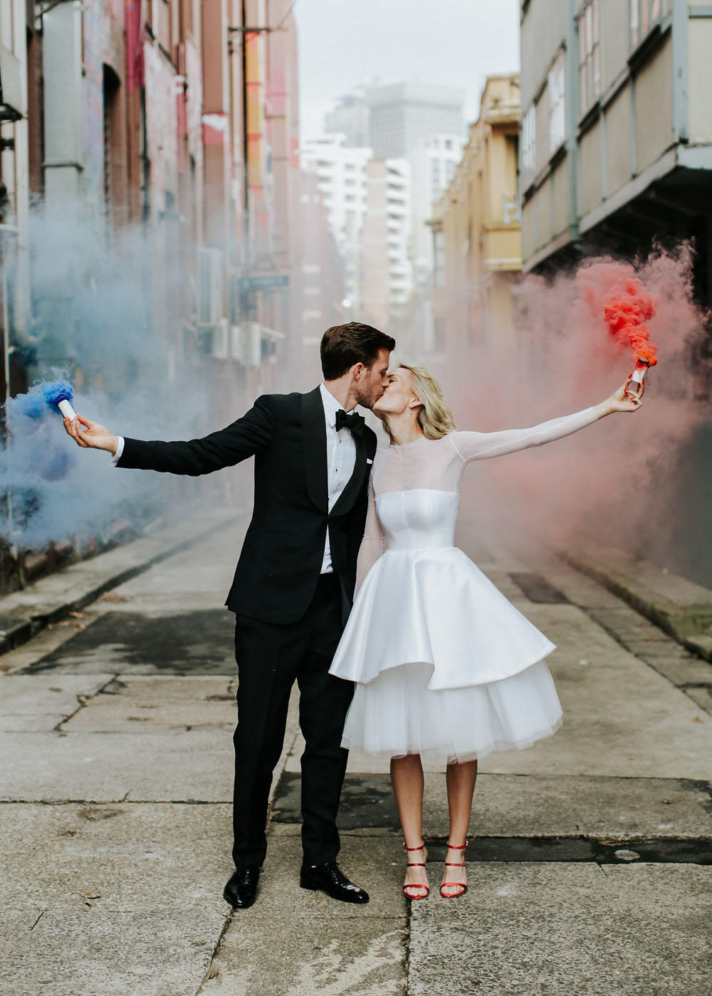 Urban chic wedding street scene with flares