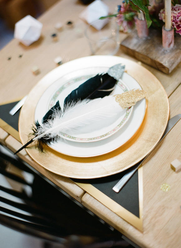 monochrome wedding table styling with feathers