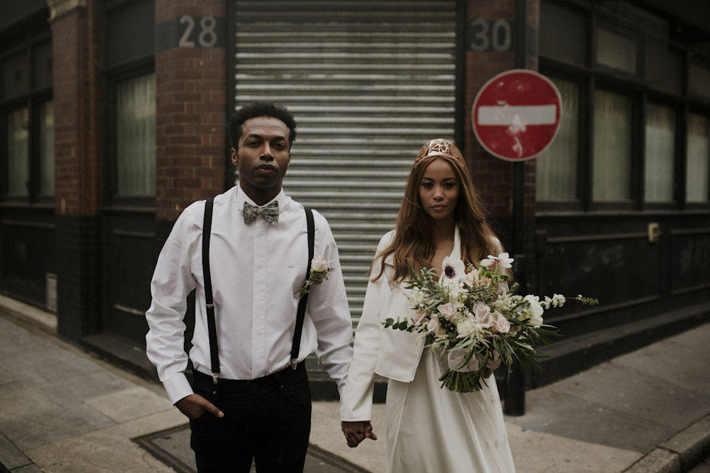 urban wedding bride and groom on the street