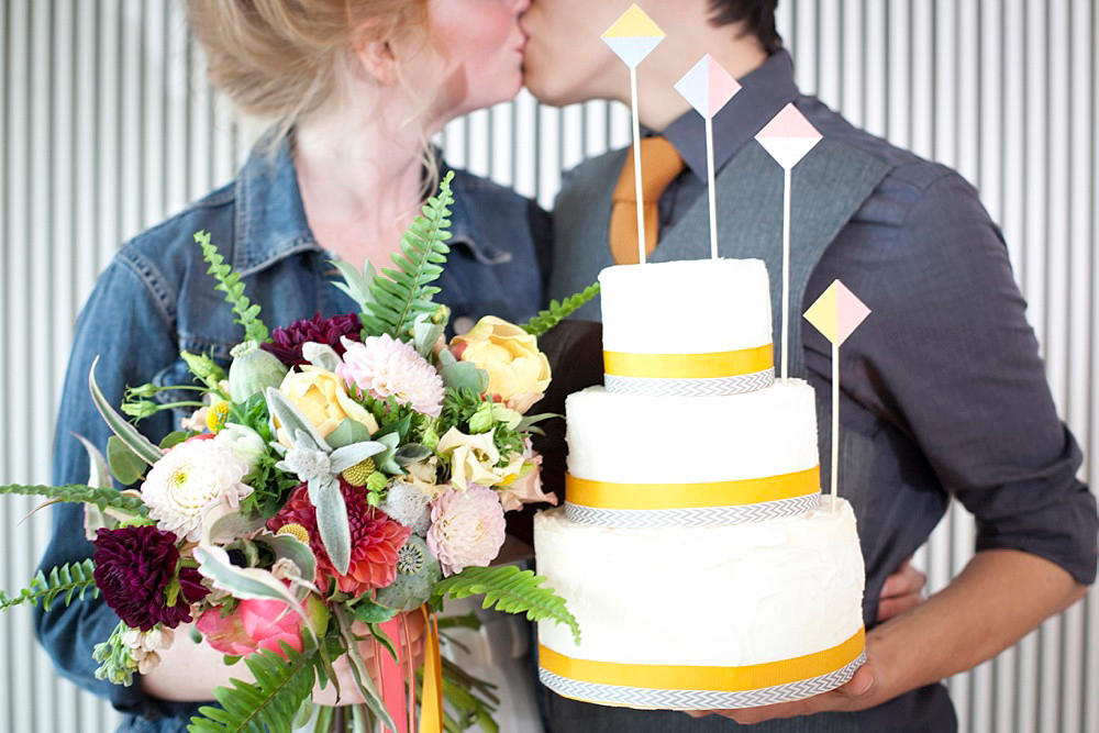 urban wedding casual bride and groom with cake
